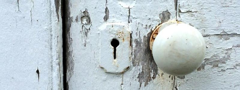 Peeling old white paint off a door
