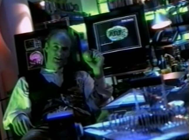 Screen shot of Dr. Tress in his lab surrounded by his machinery.