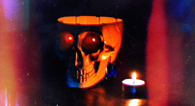Banner of hollowed-out skull beside a candle near an open window.