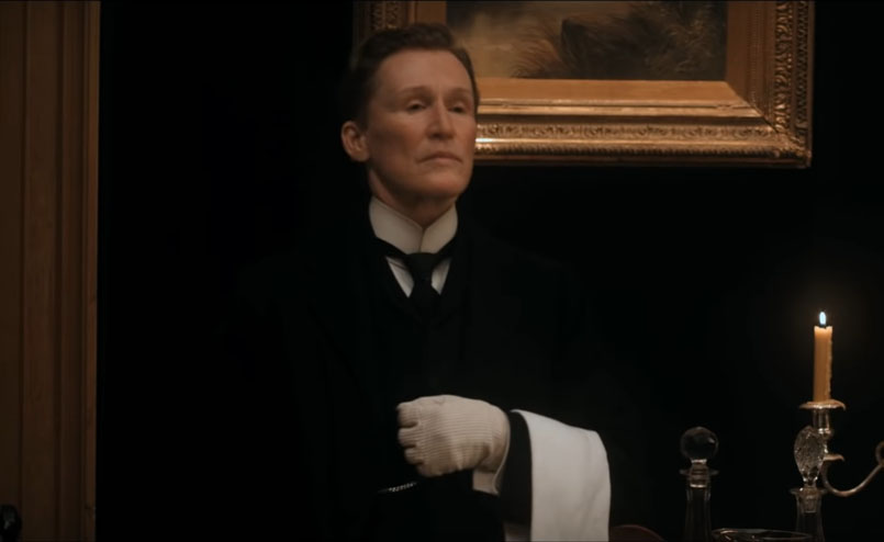 Screenshot of Albert Nobbs (2011). Albert Nobbs on the job in the dining area at the hotel.