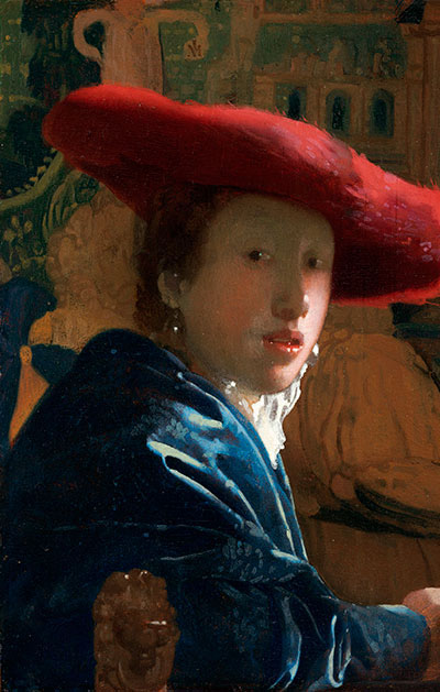 Painting of  Girl with a Red Hat by  Johannes Vermeer, 1665-1666. Woman in a large brim hat looking at the viewer wearing a deep blue jacket.