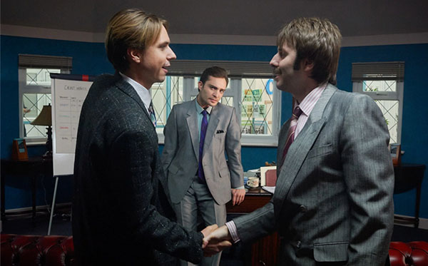Screen shot of BBC Two's White Gold. Martin Lavender (left) and Brian Fitzpatrick (right) are shaking hands in the office while Vincent Swan piers in.