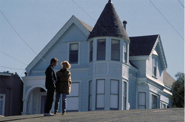 Screenshot of Pacific Heights.  The couple are standing outside of the house.
