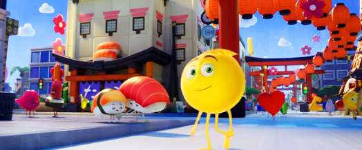 Screenshot of the Emoji Movie with main character walking across the screen in a city setting with other emojis in the background.