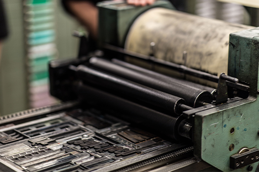 Old printing machine printing black ink.