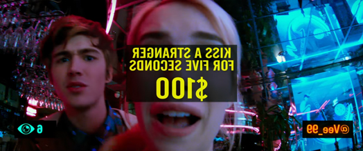 Screenshot of movie Nerve. Girl is inside of a restaurant with her friend under blue lighting.