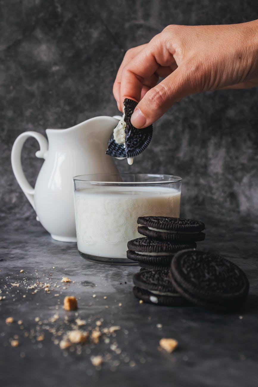 Person dunking Oreo cookies