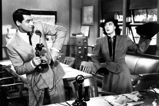 Screenshot of His Girls Friday (1940) a purse is about to be thrown at Cary Grant by his ex-wife at the newspaper office while holding a 1920's telephone.