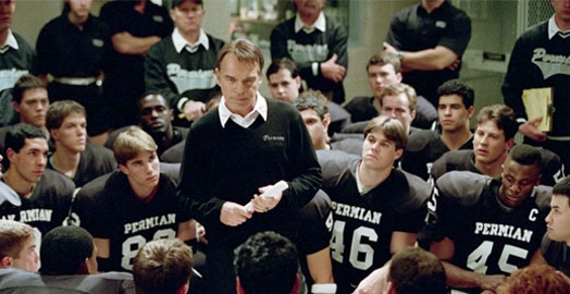 Screenshot of Friday Night Lights (2004) with Billy Bob Thornton giving an inspirational speech to the team.