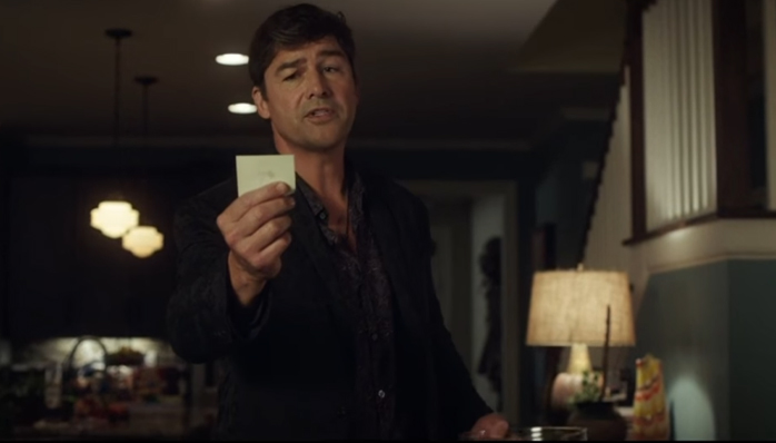 Screenshot of Brooks winning at guess that name game. A man is holding a post-it note reading from it.