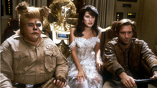 Screen shot of Space Balls. From the left: Barf, Dot Matrix, Princess Vespa and Lone Starr are in the Winnebago space craft, Eagle 5.
