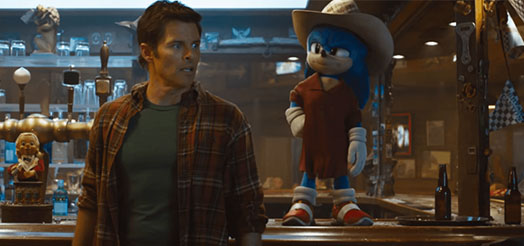 Tom and Sonic are in a bar with Sonic dressed up incognito in a big beige hat and a large brown shirt.