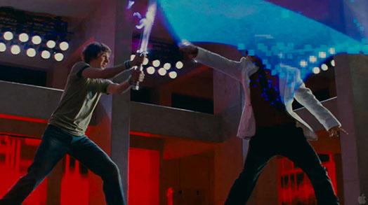 Scott is fighting the final boss. Scott has a purple fire sword and the the final boss has a blue sword that glows pixel blocks.