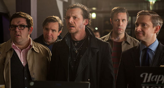 Five men in the photo with various looks of expression. Three men looked somewhat indifferent. The man in the centre looked shocked. The man standing at the right smiling at the situation.